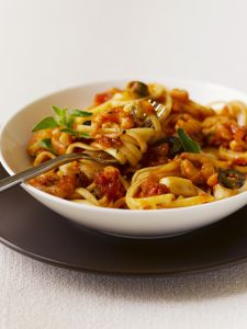 Linguine with prawns and tomato sauce, close up