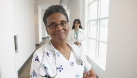 African American nurse in hospital hallway