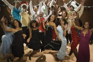Multi-ethnic teenagers cheering at prom