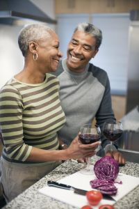 Couple laughing in kitchen together