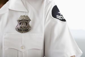 Security guard wearing badge