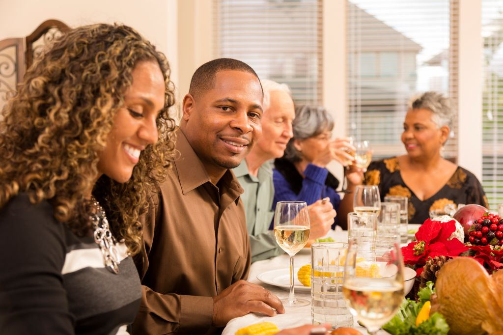 Relationships: Family and friends gather for Christmas dinner party.