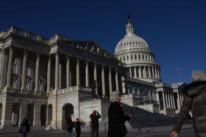 WASHINGTON DC - DECEMBER 15: Tourists gather around the US Cap