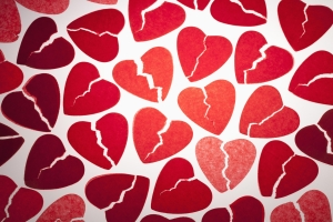 A bunch of red tissue paper broken hearts
