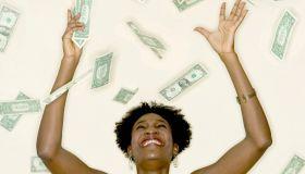 Woman Catching Falling Money