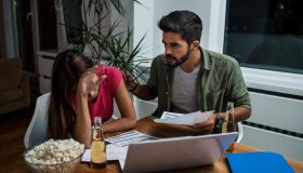 Worried young couple with financial bills