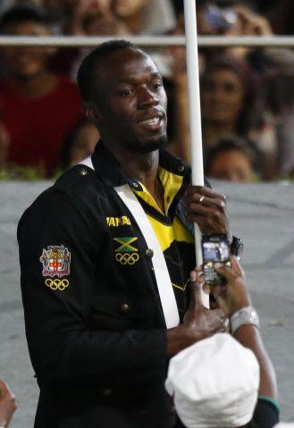 Jamaica's flagbearer Usain Bolt leads hi