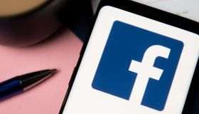 In this photo illustration a Facebook logo displayed on a...